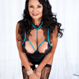 Grannie XXX starlet Rita Daniels bares her big boobies before slurping and jerking a dildo