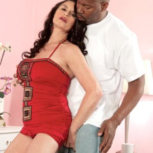 Jaw-dropping black-haired grannie Rita Daniels entices a junior ebony stud with her fine legs
