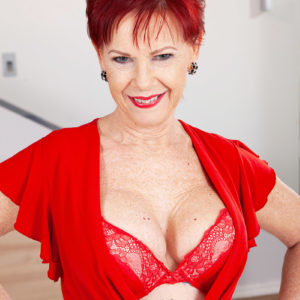 Over 60 red-haired Caroline Hamsel plays with her tits garbed crotchless underwear