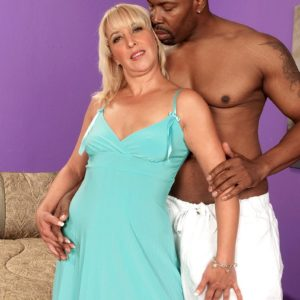 Seductive granny Andi Roxxx has her beaver slurped out by her youthful black lover
