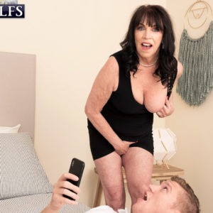 Sixty plus MILF Christina Starr seduces a young man while going sans bra in a ebony dress