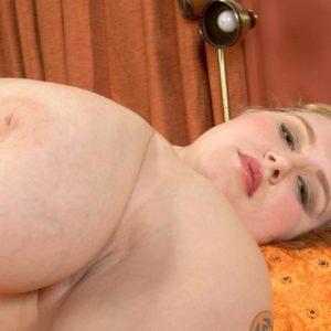 Tatted BBW Miss Isabelle takes off her satin lingerie and underwear in solo action