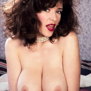 Accomplished adult flick star Diana Wynn pulls out her huge titties from her retro styled bra