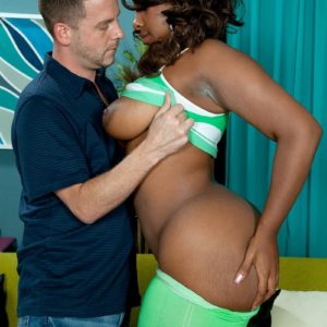 Black MILF Layla Monroe exposes her immense ebony booty as her and a white man disrobe