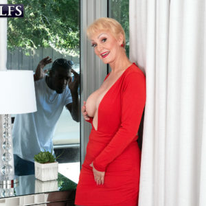 Huge-titted ash-blonde grandmother Seka black holds a Voyeurism Tom's hefty black cock in her hand
