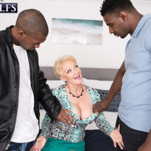 Irresistible ash-blonde grandmother Seka Black gargles on a couple of humungous black dicks during MMF sex