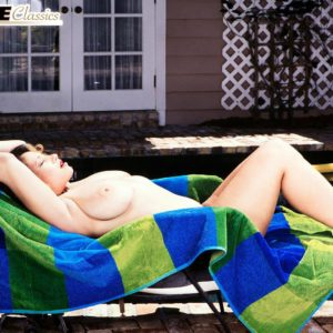 Legendary X-rated actress Via Paxton flashes her nice fun bags out by the swimming pool