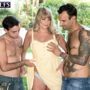 Plumper 60 plus platinum-blonde Mia Magnusson tempts the gardeners outdoors for MMF sex