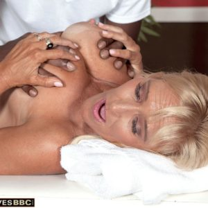 Big-titted platinum-blonde grandma Brittney Snow has her boobs toyed with by her black massagist