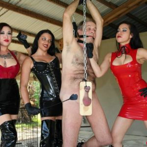 Callous females with dark hair torment a male slave clothed in spandex and lengthy boots