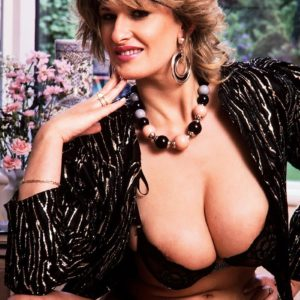Aged MILF Debbie Q proudly demonstrates her amazing breasts in ebony panties