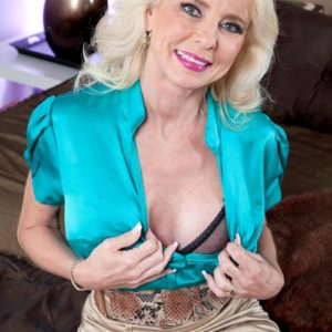 elder light-haired gal Cammille Austin seduces her paramour in a taut mini-skirt in the bedroom