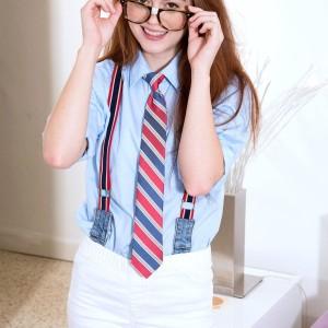Glasses garmented schoolgirl Alice Lime uncovering little teenager breasts in panties